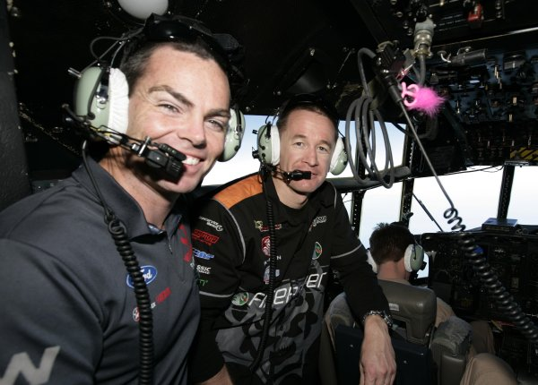 2007 Australian V8 Supercars.Bahrain International Circuit. Sakhir, Bahrain.2nd - 4th November. Craig Lowndes and Greg Murphy on the flight deck of an Australian C130 as they fly into visit the Australian troops based at Tallil Airbase located approximately 310 kilometers Southeast of Baghdad, Iraq.World Copyright: Mark Horsburgh/LAT Photographic. Ref: Digital Image V8-Drivers-IRAQ-7100
