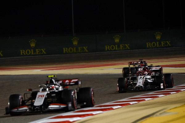 Kevin Magnussen, Haas VF-20, leads Kimi Raikkonen, Alfa Romeo Racing C39, and Pietro Fittipaldi, Haas F1 Haas VF-20