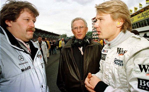 1997 San Marino Grand Prix.Imola, Italy.25-27 April 1997.Mika Hakkinen (McLaren Mercedes-Benz) talks with Norbert Haug and Dr Jurgen Hubbert.World Copyright - LAT Photographic