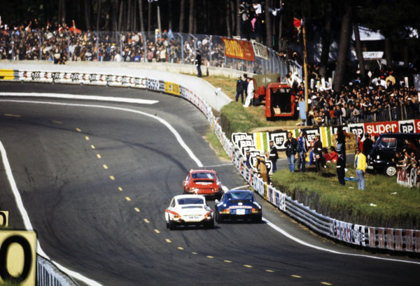 Cars battle during the race.