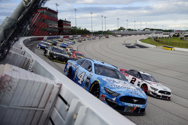 Kevin Harvick, Stewart-Haas Racing Ford Busch Light YOURFACEHERE , leads Brad Keselowski, Team Penske Ford Discount Tire Copyright: Jared C. Tilton/Getty Images.