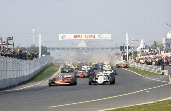 Gilles Villeneuve, Ferrari 312T4 leads Alan Jones, Williams FW07 Ford and Clay Regazzoni, Williams FW07 Ford at the start.