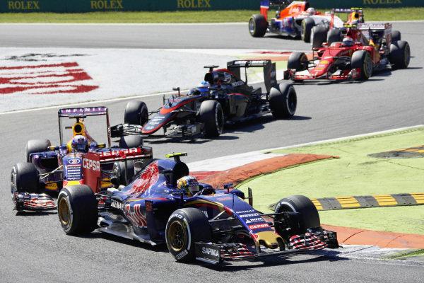 Carlos Sainz Jr, Toro Rosso STR10 Renault, Daniel Ricciardo, Red Bull RB11 Renault, Fernando Alonso, McLaren MP4-30 Honda, and Kimi Räikkönen, Ferrari SF15-T.