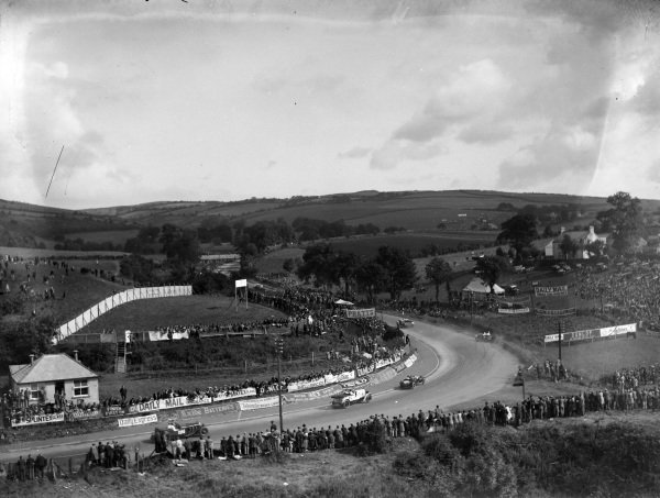 Fans watch the action on track at the start. Jack Bezzant, Aston Martin 1.5L, can be seen going off on the right of frame.