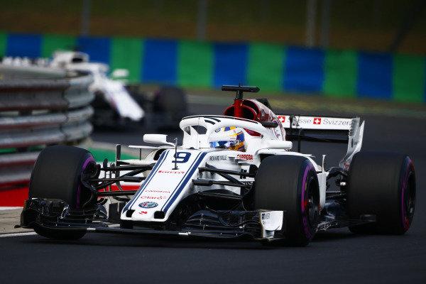 Marcus Ericsson, Sauber C37 Ferrari, leads Lance Stroll, Williams FW41 Mercedes.