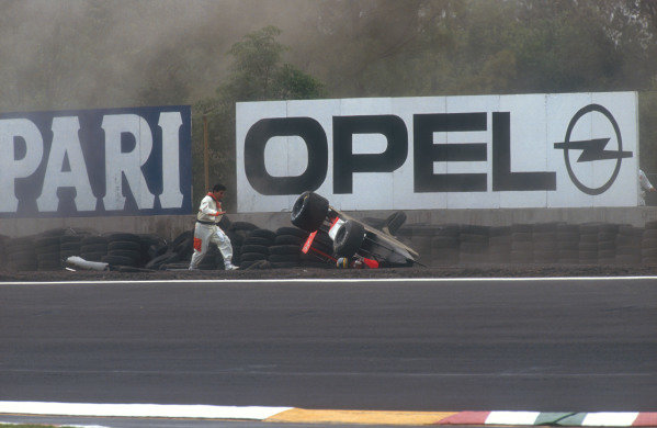 1991 Mexican Grand Prix.Mexico City, Mexico. 14-16 June 1991.Ayrton Senna (McLaren MP4/6 Honda) came off at Peraltada during Friday qualifying and hit the tyre barrier, which flipped his car over in the gravel. He was unhurt in the accident. Ref-91 MEX 03.World Copyright - Tee/LAT Photographic