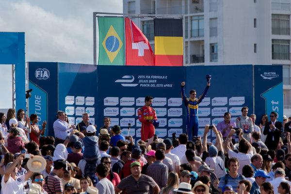 2015/2016 FIA Formula E Championship. Punta del Este ePrix, Punta del Este, Uruguay. Saturday 19 December 2015. Sebastien Buemi (SUI), Renault e.Dams Z.E.15, Lucas Di Grassi (BRA), ABT Audi Sport FE01 and Jerome D'Ambrosio (FRA) Dragon Racing - Venturi VM200-FE-01 on the podium. Photo: Zak Mauger/LAT/Formula E ref: Digital Image _L0U8898