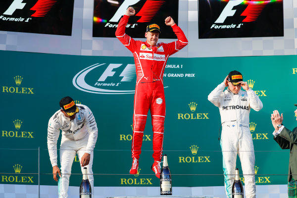 Albert Park, Melbourne, Australia. Sunday 26 March 2017. Sebastian Vettel, Ferrari, 1st Position, Lewis Hamilton, Mercedes AMG, 2nd Position, and Valtteri Bottas, Mercedes AMG, 3rd Position, celebrate on the podium. World Copyright: Glenn Dunbar/LAT Images ref: Digital Image _X4I3813