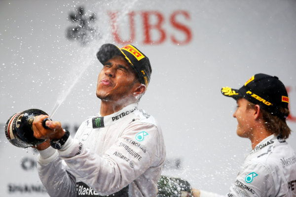 Shanghai International Circuit, Shanghai, China. Sunday 20 April 2014. Lewis Hamilton, Mercedes AMG, 1st Position, and Nico Rosberg, Mercedes AMG, 2nd Position, battle with Champagne on the podium. World Copyright: Charles Coates/LAT Photographic. ref: Digital Image _J5R7956