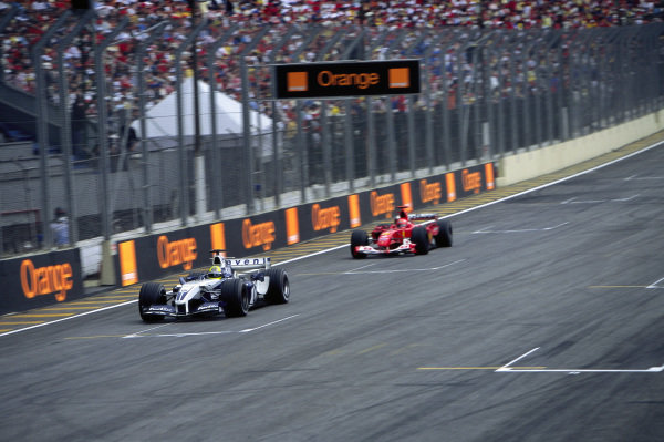 Ralf Schumacher, Williams FW26 BMW leads Michael Schumacher, Ferrari F2004.