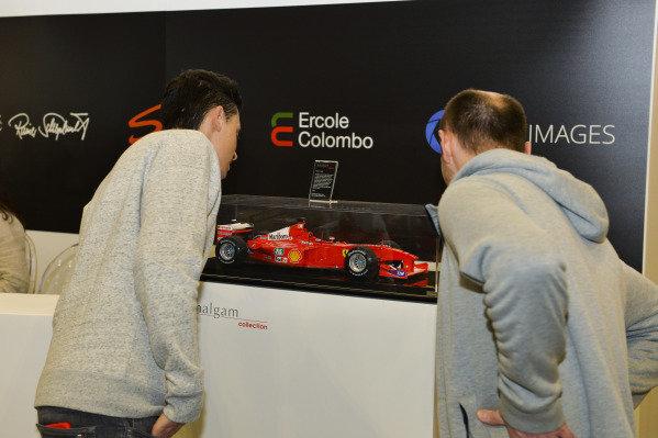 Visitors admire Amalgam models.