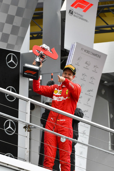 Sebastian Vettel, Ferrari celebrates on the podium with the trophy