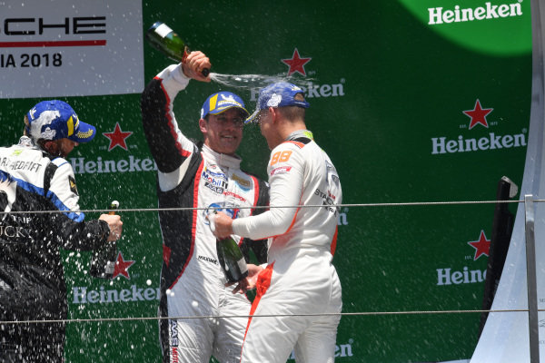 Second placed Maxime Jousse (THA) AAS Motorsport by Absolute Racing, race winner Philip Hamprecht (GER) Team StarChase and third placed Chris Van Der Drift (NZL) Team Formax celebrate on the podium with the champagne at Porsche Carrera Cup Asia, Shanghai, China, 13-15 April 2018.