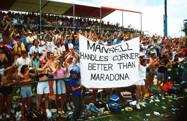 The British fans show their support for Nigel Mansell (GBR) Williams with a banner. Formula One World Championship, Rd7, British Grand Prix, Silverstone, England, 12 July 1987.
