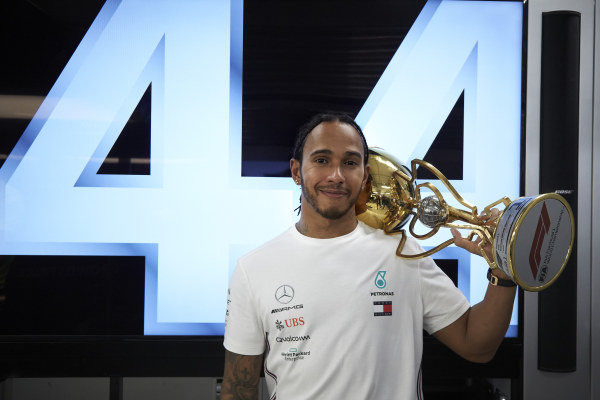 Lewis Hamilton, Mercedes AMG F1, 1st position, with his trophy