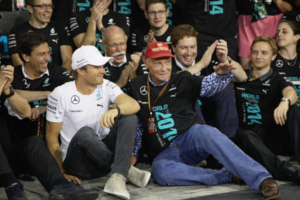 Nico Rosberg and Niki Lauda celebrates with the team.