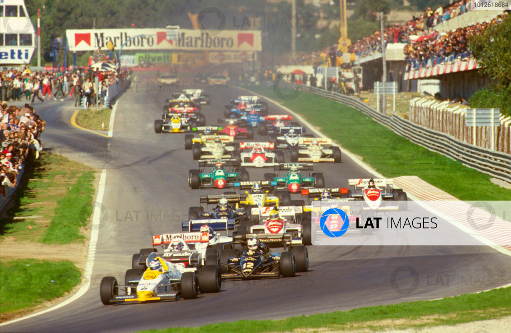 Estoril, Portugal.19-21 October 1984.Keke Rosberg (Williams FW09B Honda) leads Nigel Mansell (Lotus 95T Renault), Alain Prost (McLaren MP4\2 TAG Porsche), Nelson Piquet (Brabham BT53 BMW) and Ayrton Senna (Toleman TG184 Hart) at the start.Ref-84 POR 04.World Copyright - LAT Photographic