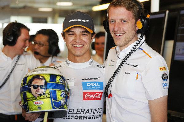 Lando Norris, McLaren, with a special helmet in the garage
