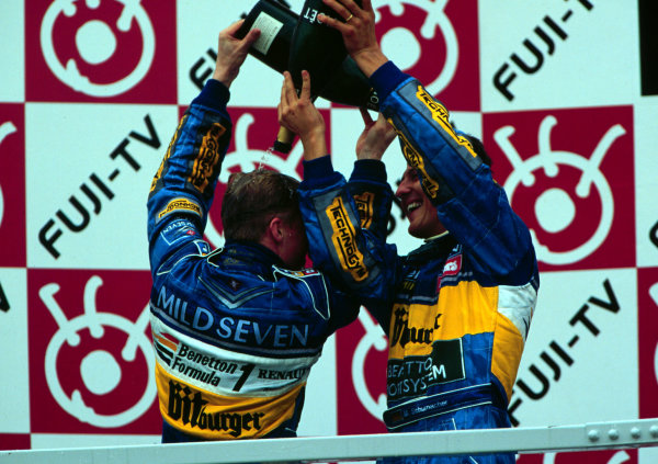 1995 Japanese Grand Prix.Suzuka, Japan.27-29 October 1995.Michael Schumacher and Johnny Herbert (both Benetton Renault) celebrate after finishing in 1st and 3rd positions respectively.World Copyright - LAT Photographicschumacherhistory