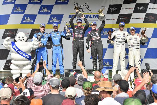 #33 Mercedes-AMG Team Riley Motorsports Mercedes-AMG GT3, GTD: Ben Keating, Jeroen Bleekemolen, #86 Meyer Shank Racing w/ Curb-Agajanian Acura NSX GT3, GTD: Mario Farnbacher, Trent Hindman, #63 Scuderia Corsa Ferrari 488 GT3, GTD: Cooper MacNeil, Toni Vilander and Michelin Man celebrate on the podium