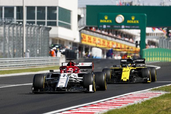 Kimi Raikkonen, Alfa Romeo Racing C38, leads Nico Hulkenberg, Renault R.S. 19