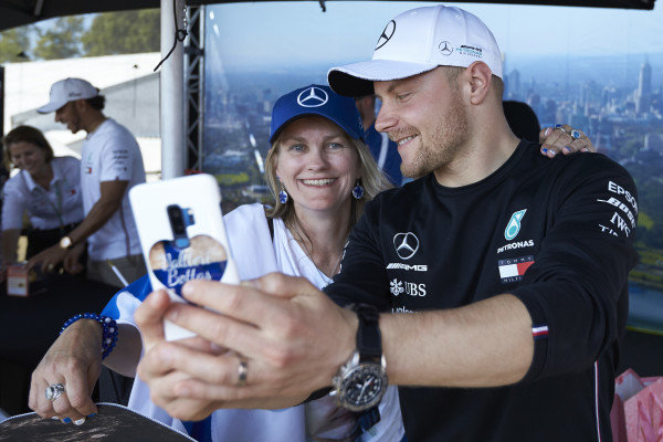 Valtteri Bottas, Mercedes AMG F1, takes a selfie with a fan