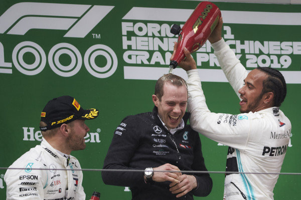 Lewis Hamilton, Mercedes AMG F1, 1st position, pours Champagne down the back of his team mate on the podium
