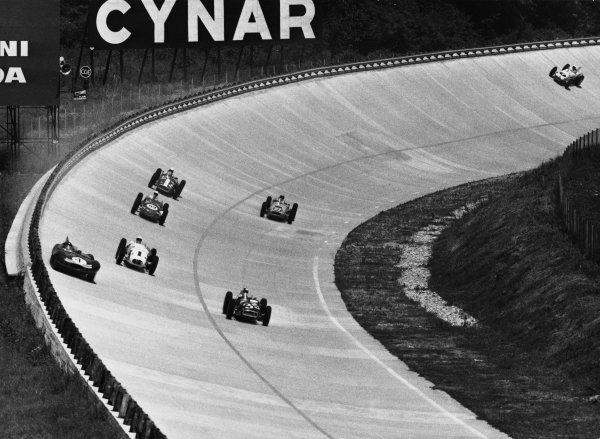 Monza, Italy. 29th June 1957.Jack Fairman, Ecurie Ecosse, Lister Jaguar D-Type, runs high on the banking, as the cars race anti-clockwise around the circuit, action.World Copyright: LAT Photographic.Ref: Autocar Used Pic Pg 27, 5th July 1957.