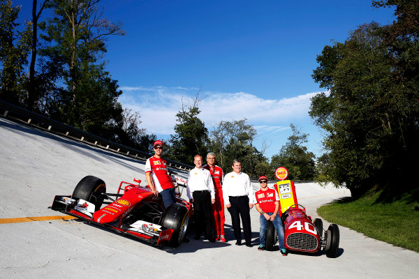 Autodromo Nazionale di Monza, Monza, Italy. Saturday 5 September 2015. Shell announce their renewed partnership with Ferrari on the Monza banking with Sebastian Vettel, Ferrari, John Abbott, Downstream Director, Shell, Mauricio Arrivabene, Team Principal, Ferrari, Istvan Kapitany, Executive Vice President of Retail, Shell and Kimi Raikkonen, Ferrari, alongside a Ferrari SF-15T and a Ferrari 166 F2 car. World Copyright: Glenn Dunbar/LAT Photographic ref: Digital Image _W2Q0710