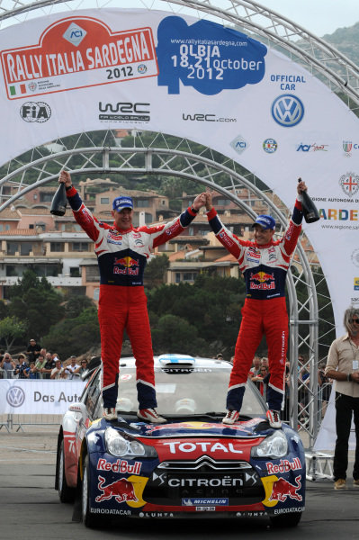 Mikko Hirvonen (FIN) and Jarmo Lehtinen (FIN), Citroen DS3 WRC, celebrate victory on the podium. FIA World Rally Championship, Rd12, Rallye Italia Sardinia, Porto Cervo, Sardinia, Italy, Day Three, Sunday 21 October 2012.
