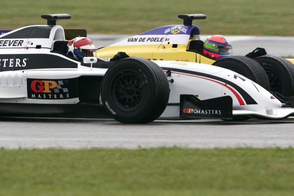 2006 Grand Prix Masters.Silverstone, England. 11th - 13th August.Eddie Cheever battles for the lead with Eric Van De Poele.Action.World Copyright: Drew Gibson/LAT Photographic.Ref: Digital Image Only.