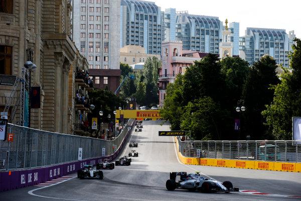 Baku City Circuit, Baku, Azerbaijan. Sunday 19 June 2016. Valtteri Bottas, Williams FW38 Mercedes leads Lewis Hamilton, Mercedes F1 W07 Hybrid, at the start of the race World Copyright: Sam Bloxham/LAT Photographic ref: Digital Image _SLA3500