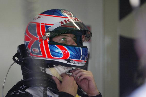 2004 German Grand Prix - Friday Practice, Hockenheim, Germany. 23rd July 2004 Jenson Button, BAR Honda 006, puts on his crash helmet.World Copyright: Steve Etherington/LAT Photographic ref: Digital Image Only