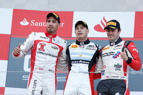2013 GP3 Series. Round 4.  Nurburgring, Germany.  6th July 2013.  Saturday Race. Facu Regalia (ARG, ART Grand Prix) celebrates his victory on the podium with Tio Ellinas (CYP, Marussia Manor Racing) and Jack Harvey (GBR, ART Grand Prix).  World Copyright: Alastair Staley/GP2 Series Media Service. Ref: _R6T7286