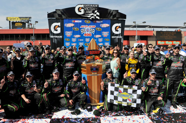 22-24 March 2013, Fontana, California USA Kyle Busch and team Toyota in Victory Lane ©2013, Scott R LePage LAT Photo USA