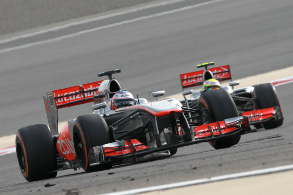 Bahrain International Circuit, Sakhir, Bahrain Sunday 21st April 2013 Jenson Button, McLaren MP4-28 Mercedes, leads Sergio Perez, McLaren MP4-28 Mercedes.  World Copyright: Andy Hone/LAT Photographic ref: Digital Image HONY1277