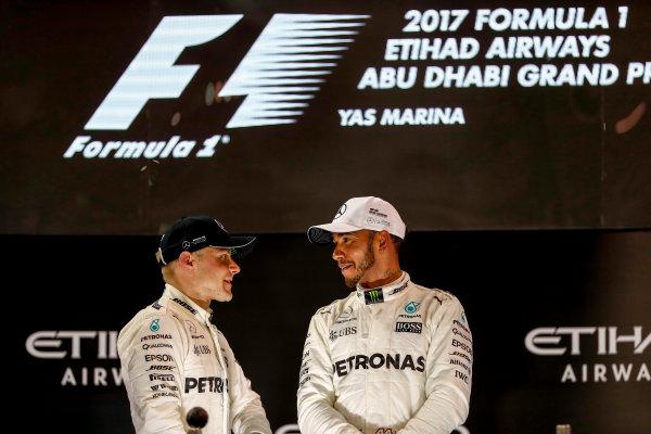 Yas Marina Circuit, Abu Dhabi, United Arab Emirates. Sunday 26 November 2017. Valtteri Bottas, Mercedes AMG, 1st Position, and Lewis Hamilton, Mercedes AMG, 2nd Position, on the podium. World Copyright: Glenn Dunbar/LAT Images  ref: Digital Image _X4I0003