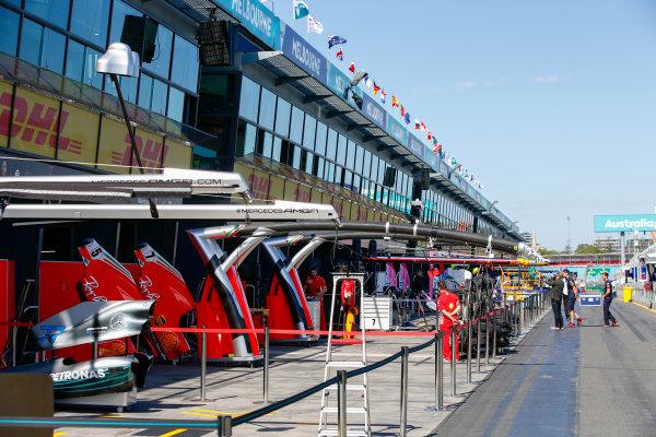 Mercedes AMG F1 and Ferrari garages in the pitman.