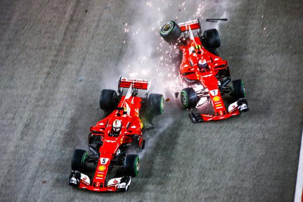 Marina Bay Circuit, Marina Bay, Singapore. Sunday 17 September 2017. Sebastian Vettel, Ferrari SF70H, and Kimi Raikkonen, Ferrari SF70H, crash out at the start. World Copyright: Andy Hone/LAT Images  ref: Digital Image _ONZ7666