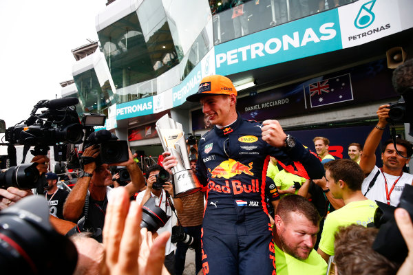 Sepang International Circuit, Sepang, Malaysia. Sunday 1 October 2017. Max Verstappen, Red Bull, 1st Position, celebrates with his team and his trophy. World Copyright: Andrew Hone/LAT Images  ref: Digital Image _ONY5600