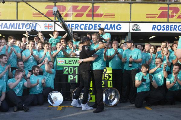 Albert Park, Melbourne, Australia. Sunday 15 March 2015. Lewis Hamilton, Mercedes AMG celebrates with his team after winning the race. World Copyright: Steve Etherington/LAT Photographic. ref: Digital Image SNE11542