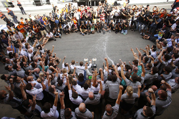 Circuit de Catalunya, Barcelona, Spain. Sunday 11 May 2014. The Mercedes AMG team celebrate a perfect weekend, during which they acheived a 1-2 finish for drivers Lewis Hamilton, Mercedes AMG, and Nico Rosberg, Mercedes AMG. World Copyright: Steven Tee/LAT Photographic. ref: Digital Image _L4R4465