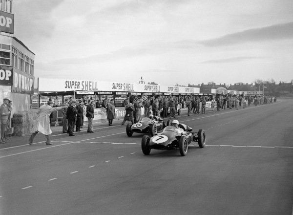 Aintree, England. 19th April 1958.Stirling Moss (Cooper-Climax T45), 1st position, beats Jack Brabham (Cooper-Climax T45), 2nd position, by 0 2 of a second, action.World Copyright: LAT Photographic.Ref: Autocar Glass Plate C51295.