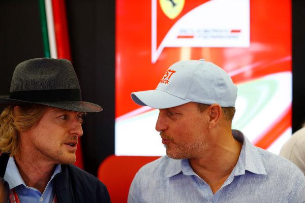 Silverstone, Northamptonshire, UK.  Sunday 16 July 2017. Owen Wilson and Woody Harrelson in the Ferrari garage. World Copyright: Glenn Dunbar/LAT Images  ref: Digital Image _31I6248