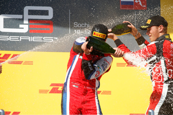 2014 GP3 Series. Round 8.   Sochi Autodrom, Sochi, Russia. Sunday Race 2 Sunday 12 October 2014. Patric Niederhauser (SUI, Arden International) sprays the champagne on the podium with Marvin Kirchhofer (GER, ART Grand Prix). Photo: Glenn Dunbar/GP3 Series Media Service. ref: Digital Image _89P3021