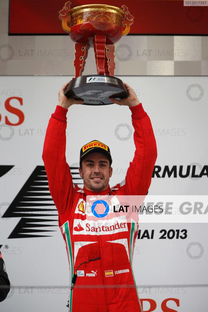 Shanghai International Circuit, Shanghai, China Sunday 14th April 2013 Fernando Alonso, Ferrari, 1st position, celebrates on the podium. World Copyright: Glenn Dunbar/LAT Photographic ref: Digital Image _89P8980
