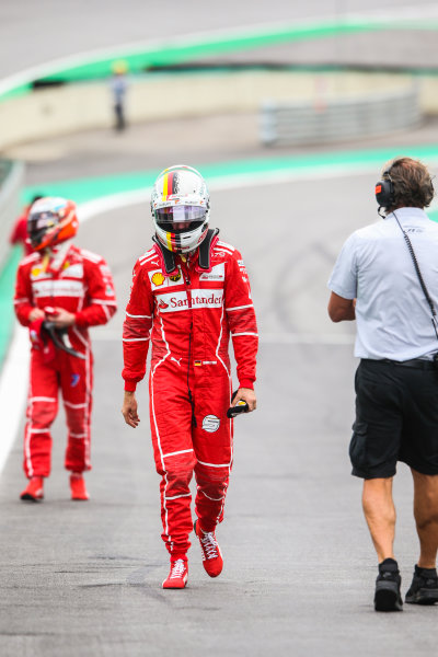 Interlagos, Sao Paulo, Brazil. Saturday 11 November 2017. Sebastian Vettel, Ferrari, and Kimi Raikkonen, Ferrari, walk to Parc Ferme after mistakenly parking on the grid after Qualifying. World Copyright: Charles Coates/LAT Images  ref: Digital Image AN7T3921