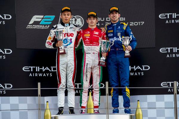 2017 FIA Formula 2 Round 11. Yas Marina Circuit, Abu Dhabi, United Arab Emirates. Sunday 26 November 2017. Alexander Albon (THA, ART Grand Prix), Charles Leclerc (MCO, PREMA Racing), Nicholas Latifi (CAN, DAMS).  Photo: Zak Mauger/FIA Formula 2. ref: Digital Image _56I2579