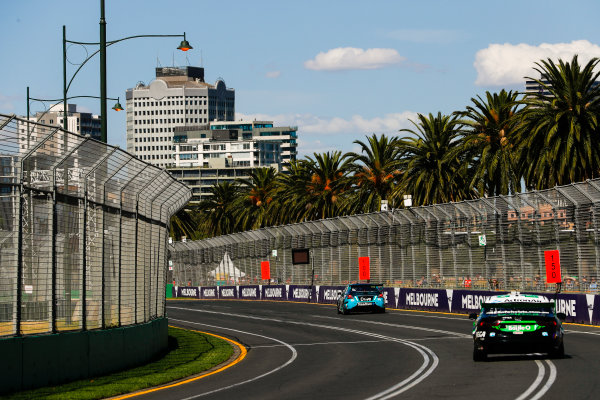Michael Caruso, Nissan Motorsport Nissan, leads Mark Winterbottom, Tickford Racing Ford.