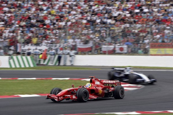 2007 French Grand Prix - Sunday RaceCircuit de Nevers Magny Cours, Nevers, France.1st July 2007.Felipe Massa, Ferrari F2007, 2nd position, puts a lap on Alex Wurz, Williams FW29 Toyota, 14th position. Action. World Copyright: Andrew Ferraro/LAT Photographicref: Digital Image VY9E3368